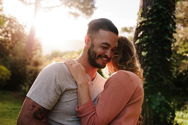 Couple hugging outside