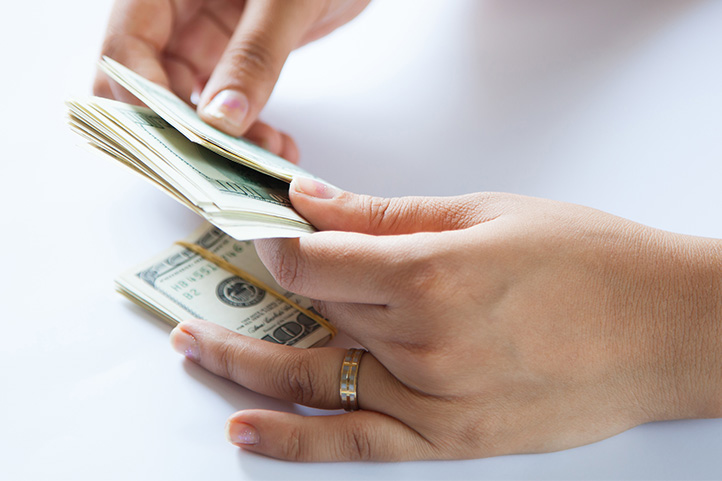 Image of a woman holding money