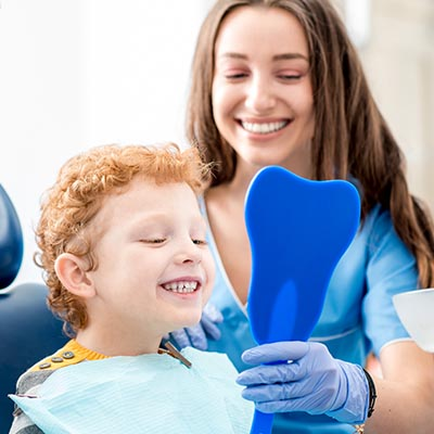 Woman and Child Smiling in Dental Chair