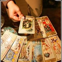Person giving a psychic tarot card reading at Astrology Boutique in Chicago.