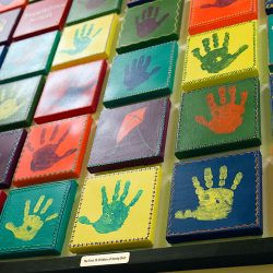 Hand print artwork by children at Strong Start Early Learning Center