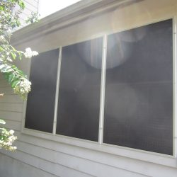 Three Black Solar Window Screens - Austin Shade Team