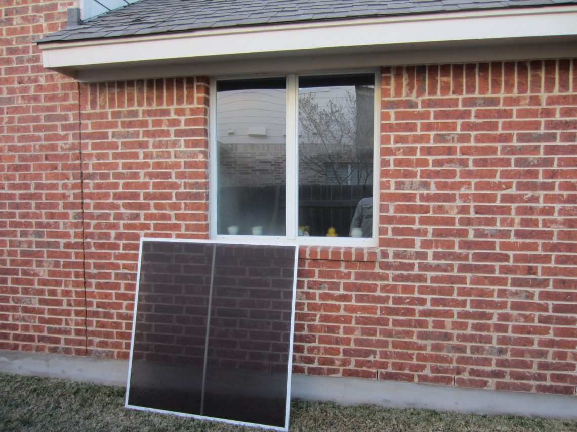 solar window screen leaning against wall