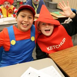 These two friends show off their costumes at the Autism Academy, a school for children with autism.
