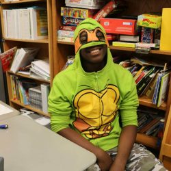 Channeling his inner ninja, this child with autism celebrates Halloween at his school for autistic children.