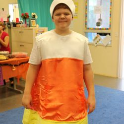 A boy with autism celebrates Halloween by dressing up at the Autism Academy, a school for children with autism.