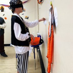 A child with autism at a Halloween party, participating in activities at the Autism Academy.