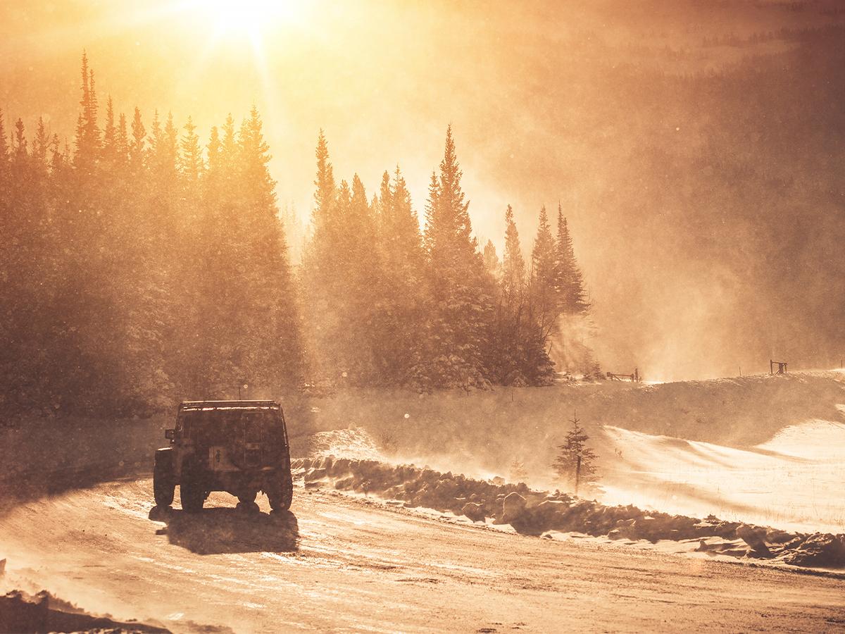 snowy roadway in mountain pass