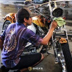 Finishing up luxury motorcycle detailing on a custom motorcycle with flames