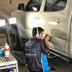 Buffing a white truck as part of one of our luxury auto detailing packages