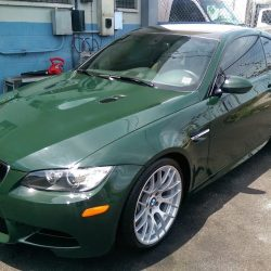 Luxury auto detailing for a green BMW