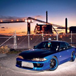 Sunset behind a black and blue Skyline GT-R with luxury auto detailing in Honolulu