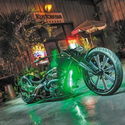 Motorcycle detailing with custom paint and green lights