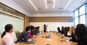 Woman leads meeting in office Automated Lights and Shades Manhattan
