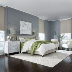 Dark-wood bedroom with tan shades lowered Automated Lights and Shades Manhattan