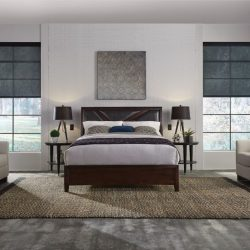 Wood-floor bedroom with black shades lowered Automated Lights and Shades Manhattan