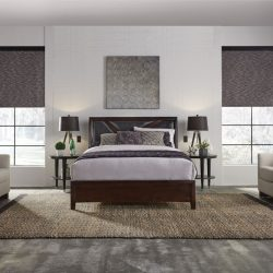 Bed and two chairs with gray shades lowered Automated Lights and Shades Manhattan