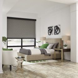 Modern bedroom with gray shades lowered Automated Lights and Shades Manhattan
