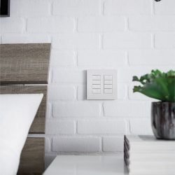 White control panel on white brick wall Automated Lights and Shades Manhattan