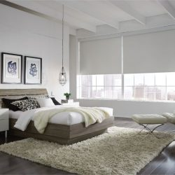 Light bedroom with white shades lowered Automated Lights and Shades Manhattan