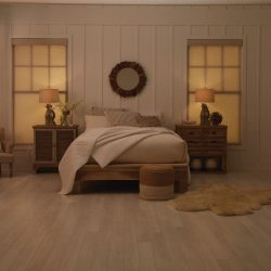 Wood-floor bedroom with tan shades closed Automated Lights and Shades Manhattan