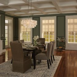 Dining room with hanging lights and shades lowered Automated Lights and Shades Manhattan
