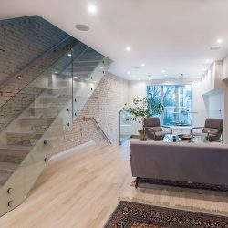Staircase on brick wall with light fixtures Automated Lights and Shades Manhattan