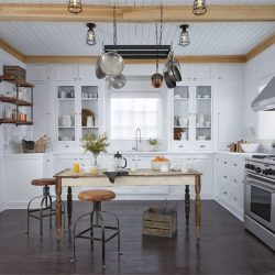 Wood-floor kitchen with white shades closed Automated Lights and Shades Manhattan