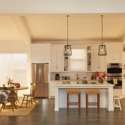 White, open kitchen with white shades closed Automated Lights and Shades Manhattan