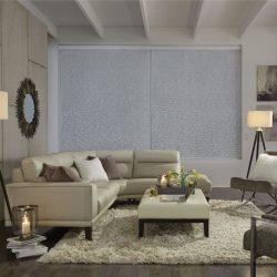 White couch in front of closed wide shades Automated Lights and Shades Manhattan
