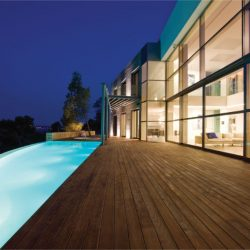 Pool on deck outside of well-lit house Automated Lights and Shades Manhattan
