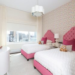 Pink beds, polka-dot walls with shades closed Automated Lights and Shades Manhattan