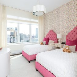 Pink beds, polka-dot walls with shades open Automated Lights and Shades Manhattan