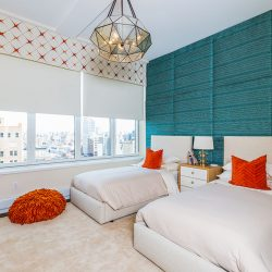 White beds, Blue wall with shades lowered Automated Lights and Shades Manhattan