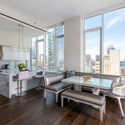 Living room and dining room overlooking sunny city Automated Lights and Shades Manhattan'