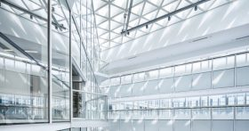 White building interior with glass windows all around