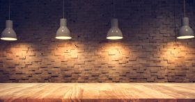 Four hanging lights above wood table