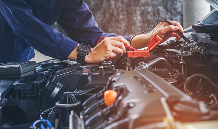Mechanic inspecting vehicle