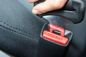 Buckling a Seatbelt Closeup