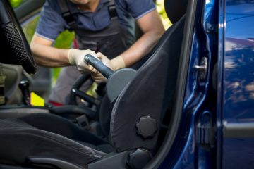 Worker Detailing Car Driver's Seat