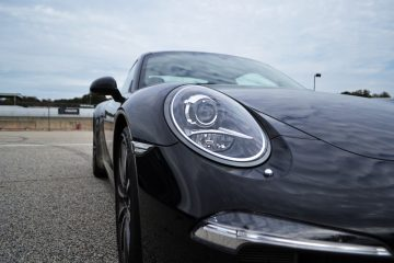 Black Porsche Headlight Closeup