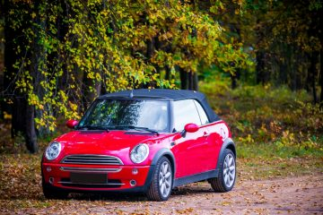 Red Mini Cooper on a Dirt Road
