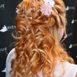 Finished hair style with floral details - Avenue Hair Salon