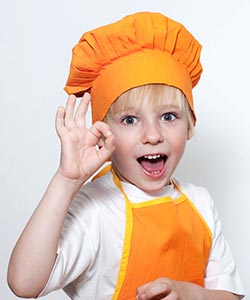 Child Wearing Chef Hat and Apron