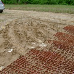 Soil Stabilization Matting On Muddy Work Site - B8 Ventures