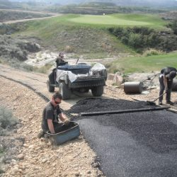 Spreading Pavement Over Erosion Control Matting - B8 Ventures