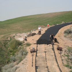 B8 Ventures Installing Erosion Control Matting On Dirt Road