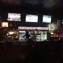 watch football on the big screen at the nearest sports bar in Lake Buena Vista