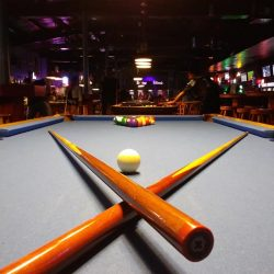 Artistic Photo of Cue sticks and balls on Pool Table