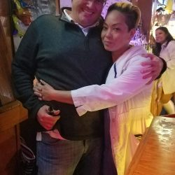Image of Couple Hugging for the Camera